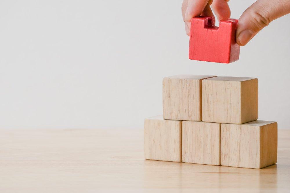 business finance. growing Profit concept,Hand arranging wood block